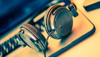 An image of a pair of earphones and a computer.